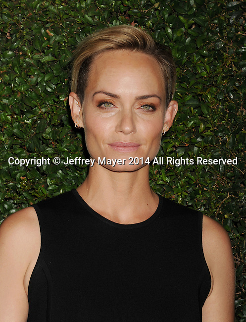 BEVERLY HILLS, CA- OCTOBER 02: Actress Amber Valletta arrives at the Michael Kors Hosts Launch Of Claiborne Swanson Frank's 'Young Hollywood' Portrait Book at a private residence on October 2, 2014 in Beverly Hills, California.