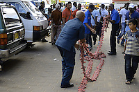 Workers laying hundred meters long of firecrackers on a sidewalk while inhabitants walking around them.....End of year 2010 celebrations on the streets of Paramaribo. Suriname is one of biggest consumer in South America that using firecrackers, fireworks ( also locally known as pagara ) for celebrations, especially for end of every years and also beginning of every new Chinese Years.