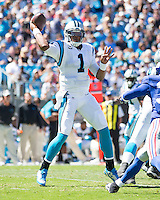 The Carolina Panthers played the New York Giants at Bank of America Stadium in Charlotte, NC.  The Panthers won 38-0 for their first victory of the season.  The Giants dropped to 0-3.  Carolina Panthers quarterback Cam Newton (1), New York Giants cornerback Aaron Ross (31)