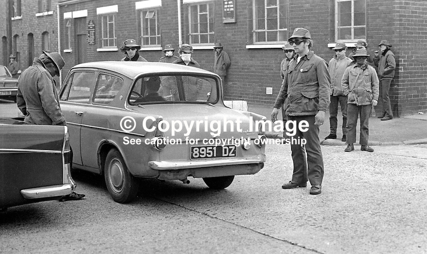 Masked members of the loyalist para-military Ulster Defence Association operating a vehicle checkpoint in the predominently Protestant Woodvale district of Belfast, N Ireland, UK, on 14th May 1972. 197205140563h<br />