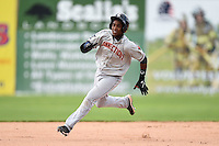 Connecticut Tigers shortstop Domingo Leyba (7) running the bases during the second game of a doubleheader against the Batavia Muckdogs on July 20, 2014 at Dwyer Stadium in Batavia, New York.  Connecticut defeated Batavia 2-0.  (Mike Janes/Four Seam Images)