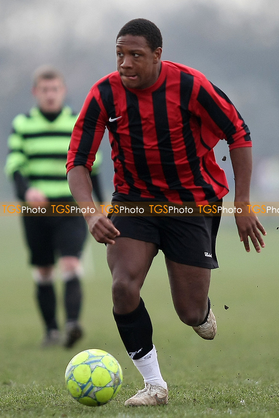 Flamengo All Stars (Green&Black Hoops) v Snaresbrook (Red&Black Stripes), Wanstead Flats - Essex Sunday Football Combination - 11/03/12 - MANDATORY CREDIT: George Phillipou/TGSPHOTO - Self billing applies where appropriate - 0845 094 6026 - contact@tgsphoto.co.uk - NO UNPAID USE.
