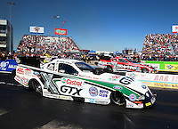 Sept. 22, 2013; Ennis, TX, USA: NHRA funny car driver John Force (near lane) races alongside daughter Courtney Force during the Fall Nationals at the Texas Motorplex. Mandatory Credit: Mark J. Rebilas-