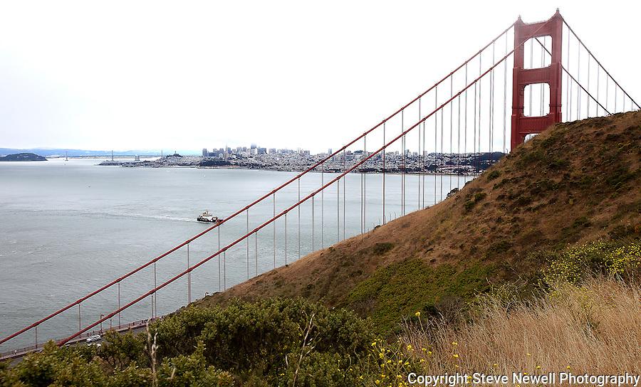"""The Two Bridges""  San Francisco, California.  A view of the East Bay Bridge through the Golden Gate Bridge."