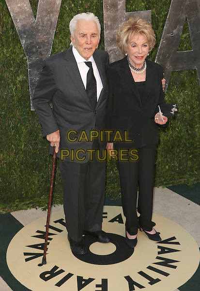 Kirk Douglas, Anne Buydens.2013 Vanity Fair Oscar Party following the 85th Academy Awards held at the Sunset Tower Hotel, West Hollywood, California, USA..February 24th, 2013.oscars full length black grey gray suit holding hands cane married husband wife .CAP/ADM/SLP/DOW.©Dowling/StarlitePics/AdMedia/Capital Pictures