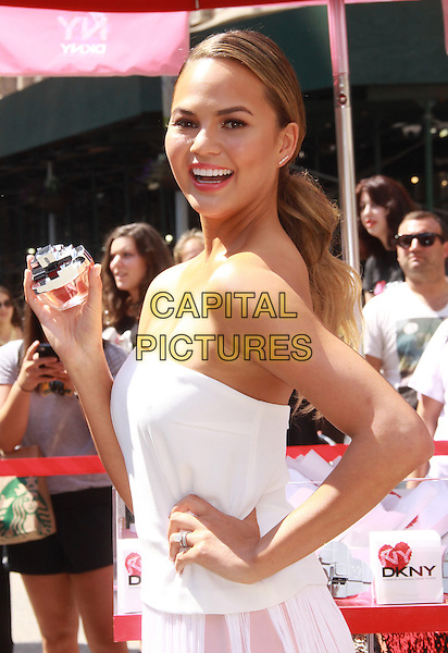 NEW YORK, NY - AUGUST 19: Chrissy Teigen at the Launch of The New DKNY MYNY Fragrance in New York City on August 19, 2014.  <br /> CAP/MPI/RW<br /> &copy;RW/ MediaPunch/Capital Pictures