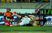 TJ Perenara tackles Damien McKenzie into touch during the Super Rugby semifinal match between the Hurricanes and Chiefs at Westpac Stadium, Wellington, New Zealand on Saturday, 30 July 2016. Photo: Dave Lintott / lintottphoto.co.nz