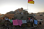 Laundry from Israeli soldiers hangs on the side of an armored vehicle at an army position near the Lebanese border in northern Israel , Saturday Aug. 5, 2006.Photo By JINI/AHMAD GHARABLI/EPA