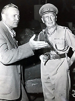 BNPS.co.uk (01202 558833)<br /> Pic Lawrences/BNPS<br /> <br /> Desmond Young (r) playing himself in 'The Desert Fox' movie in 1950.<br /> <br /> Extraordinary tale of Anglo-German post war  friendship emerges...<br /> <br /> The official car standard for legendary German commander Erwin Rommel is being sold by the family of a former British officer who befriended his widow after the war.<br /> <br /> Brig Desmond Young was captured by the Nazis in Libya and while being interrogated, Rommel personally intervened to protect him.<br /> <br /> After the war Mr Young befriended Rommel's widow Lucia and wrote a biography called 'Rommel: The Desert Fox'.<br /> <br /> Mr Young and Frau Rommel struck up a friendship and she presented him with the standard after he gifted her the European rights to his book as an act of kindness due to her penniless state.<br /> <br /> Estimated at £12,000, the historic item will go under the hammer at Lawrence's auction house in Crewkerne, Somerset on November 14th.