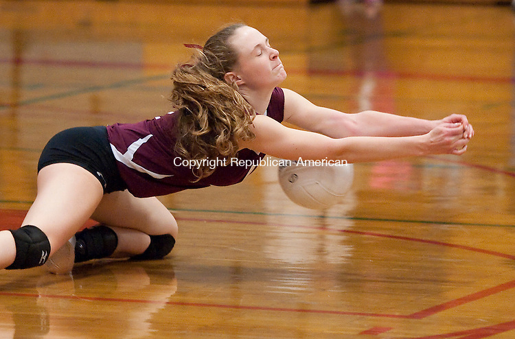 TORRINGTON, CT--- -111215JS09-Torrington's Candyce Jewett (1) dives unsuccessfully for the ball during their second round Class L tournament game against Avon Thursday at Torrington High School.<br /> Jim Shannon Republican-American