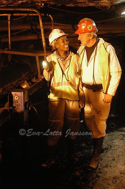 Neo Kgengwe underground with Gert Bezuidenhout, Neo?s training manager at Total Coal, whom she calls Oom (uncle). ..                    ...