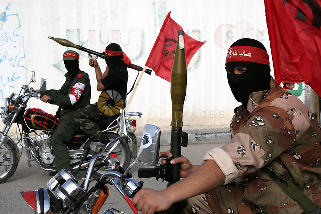 Palestinian militants of the Democratic front for the liberation of Palestine (DFLP) take part in an anti-Israel military show in the central Gaza Strip February 22, 2010. Photo by Ashraf Amra