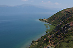 Lin-Pogradec-Albania - August 02, 2004---Partial view of the shore at the peninsula of Lin and the Lake Ohrid (wih Macedonian mountains and shore at the horizon); region/village of project implementation by GTZ-Wiram-Albania (German Technical Cooperation, Deutsche Gesellschaft fuer Technische Zusammenarbeit (GTZ) GmbH); landscape-nature---Photo: © HorstWagner.eu