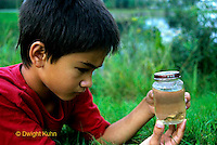 1O15-001z  Child looking at caught dragonfly nymphs - Pond - PRA