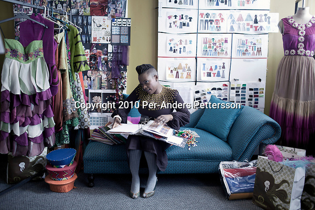 JOHANNESBURG, SOUTH AFRICA - MAY 17:  Nkhensani Nkosi, age 37, a mother of four and a celebrated fashion designer, entrepreneur, television personality and an actress, talks to clients on her mobile phone in her studios on May 17, 2010, in Johannesburg, South Africa. Celebrated for her fashion brand Stoned Cherry her clothes are worn by celebrities and she had a successful show at the New York Fashion Week in 2009. (Photo by Per-Anders Pettersson)