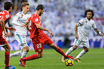 Marcos Llorente of Real Madrid (L) fights for the ball with Franco Vazquez of Sevilla FC (R) during La Liga 2017-18 match between Real Madrid and Sevilla FC at Santiago Bernabeu Stadium on 09 December 2017 in Madrid, Spain. Photo by Diego Souto / Power Sport Images