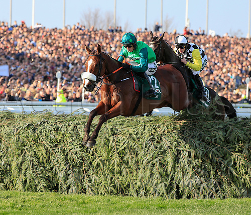 14h April 2018, Aintree Racecourse, Liverpool, England; The 2018 Grand National horse racing festival sponsored by Randox Health, day 3; Ucello Conti leads The Grand National over the water jump