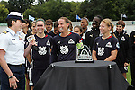 30 August 2009: The WPS All-Star team captain Christie Rampone (center)(NJ) is presented the All Star Trophy as her team shares in the moment.  The WPS All-Star team defeated the visiting Umea IK 4-2 in the first annual post season All-Star game of the Women's Professional  Soccer league at Anheuser-Busch Soccer Park, in Fenton, MO.