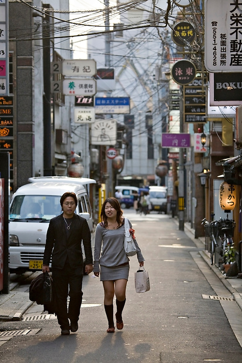 Couple walking down side street in Kyoto Japan