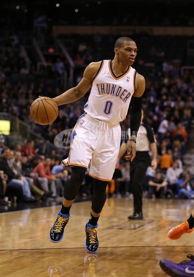 Feb. 10, 2013; Phoenix, AZ, USA: Oklahoma City Thunder point guard Russell Westbrook (0) against the Phoenix Suns at the US Airways Center. Mandatory Credit: Mark J. Rebilas-