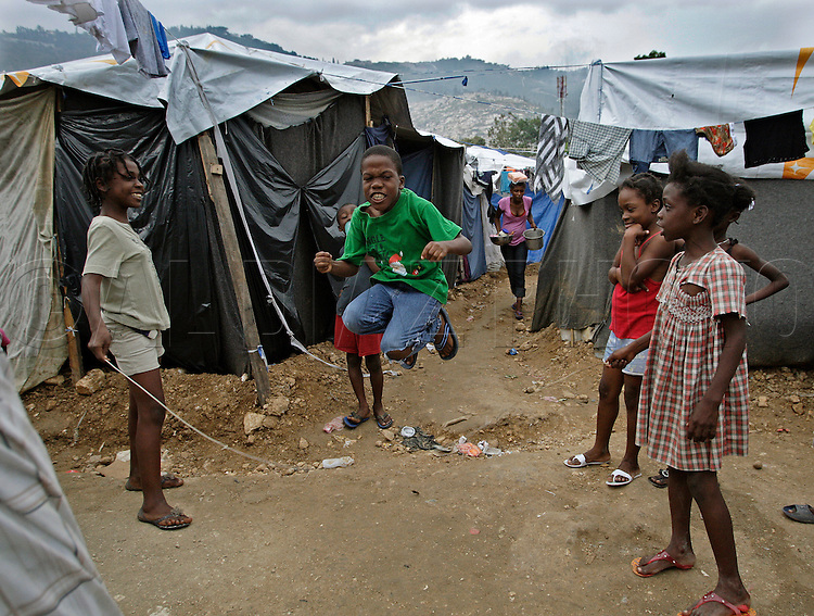 Children play jump rope at a makeshift camp on a former soccer field at Sainte Therese Park in Petion-Ville on February 27, 2010.