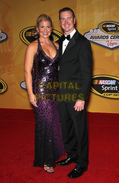 EVE & KURT BUSCH .NASCAR Sprint Cup Series Awards Ceremony at the Wynn Las Vegas, Nevada, USA, 3rd November 2010..full length black bow tie tuxedo tux purple long maxi dress sequined sequin couple married husband wife .CAP/ADM/MJT.© MJT/AdMedia/Capital Pictures.