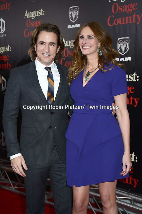 "Dermot Mulroney and Julia Roberts attends the New York Premiere of ""August: Osage County"" on December 12, 2013 at the Ziegfeld Theatre in New York City."