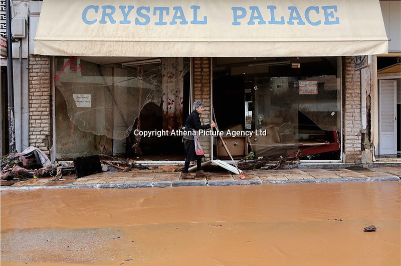 Pictured: A woman clears debris from the front of her shop.<br /> Re: Five people have reportedly died and severe damage caused by heavy rain and flash flooding in the area of Mandra, near Athens, Greece. Wednesday 15 November 2017