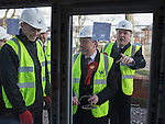 © Joel Goodman - 07973 332324 .  04/02/2014 . Manchester , UK . L-R an apprentice bricklayer , Mike Kane with a trowel and Ed Balls . Ed Balls , MP for Morley and Outwood and Shadow Chancellor of the Exchequer the Labour Party , joins Labour candidate Mike Kane on the campaign trail ahead of the Wythenshawe and Sale East by-election , following the death of MP Paul Goggins . They visit apprentices at the Leybrook Road building site in Wythenshawe where apprentice builders work on bungalows built for affordable rent . Photo credit : Joel Goodman