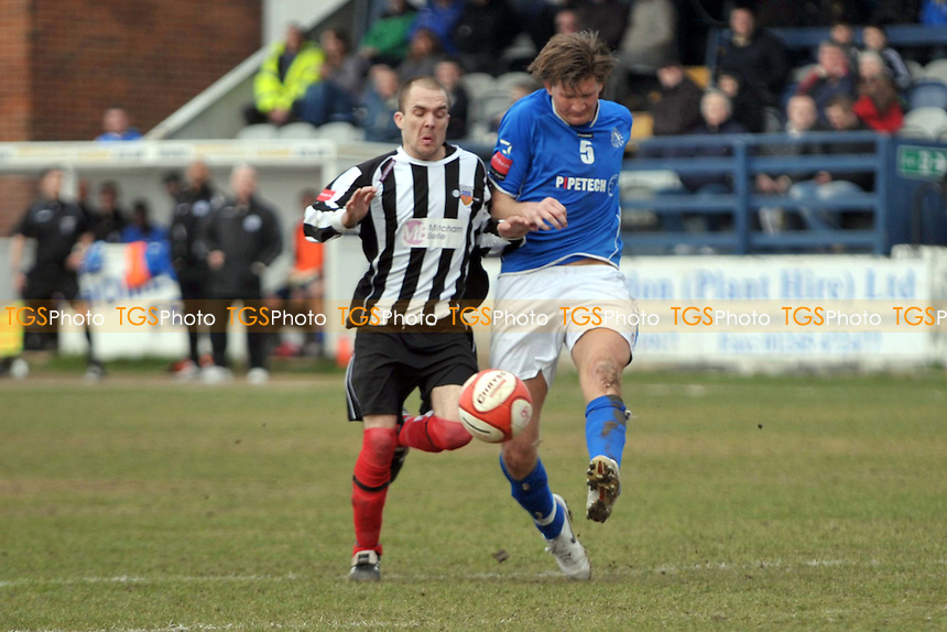 Chris Wild (Billericay) clears as he is challenged by Jamie Byatt (Tooting) - Billericay Town vs Tooting & Mitcham United - Ryman League Premier Division at New Lodge - 12/03/11 - MANDATORY CREDIT: Garry Bowden/TGSPHOTO - Self billing applies where appropriate - 0845 094 6026 - contact@tgsphoto.co.uk - NO UNPAID USE.