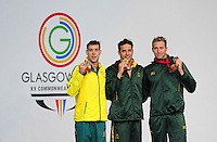 The podium for the men's 200m butterfly.  From left, silver medalist Australia's Grant Irvine, gold medalist Republic of South Africa's Chad le Clos and bronze medalist  Republic of South Africa's Sebastien Rousseau<br /> <br /> Photographer Chris Vaughan/CameraSport<br /> <br /> 20th Commonwealth Games - Day 3 - Saturday 26th July 2014 - Swimming - Tollcross International Swimming Centre - Glasgow - UK<br /> <br /> © CameraSport - 43 Linden Ave. Countesthorpe. Leicester. England. LE8 5PG - Tel: +44 (0) 116 277 4147 - admin@camerasport.com - www.camerasport.com