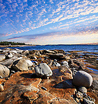 Boulders Strewn On The Rocky Shoreline At Acadia National Park, Maine, USA