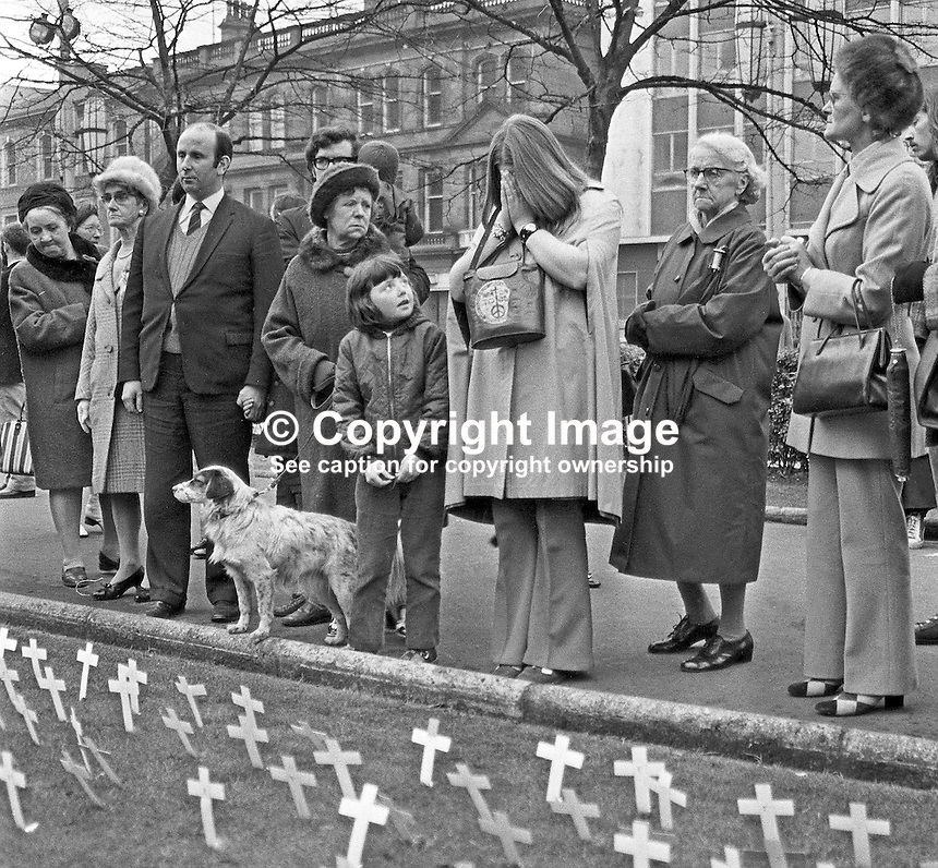As family and friends of victims assemble in the grounds of City Hall, Belfast, N Ireland, UK, to plant commemorative crosses, one woman buries her head in her hands overcome with grief. The event took place on 5 November 1972, 197211050683c.<br /> <br /> Copyright Image from Victor Patterson, 54 Dorchester Park, Belfast, UK, BT9 6RJ<br /> <br /> t1: +44 28 9066 1296 (from Rep of Ireland 048 9066 1296)<br /> t2: +44 28 9002 2446 (from Rep of Ireland 048 9002 2446)<br /> m: +44 7802 353836<br /> <br /> e1: victorpatterson@me.com<br /> e2: victorpatterson@gmail.com<br /> <br /> The use of my copyright images is subject to my Terms &amp; Conditions.<br /> <br /> It is IMPORTANT that you familiarise yourself with them. They are available on my website at www.victorpatterson.com.<br /> <br /> None of my copyright images may be used on a website unless they are visibly watermarked, i.e. &copy; Victor Patterson within the body of the visible image. Metadata denoting my copyright must NOT be deleted. <br /> <br /> Web use is extra at currently recommended NUJ rates.