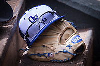 Oklahoma City Dodgers hat and glove sits on the dugout steps during a game against the Iowa Cubs at Chickasaw Bricktown Ballpark on April 9, 2016 in Oklahoma City, Oklahoma.  Oklahoma City defeated Iowa 12-1 (William Purnell/Four Seam Images)