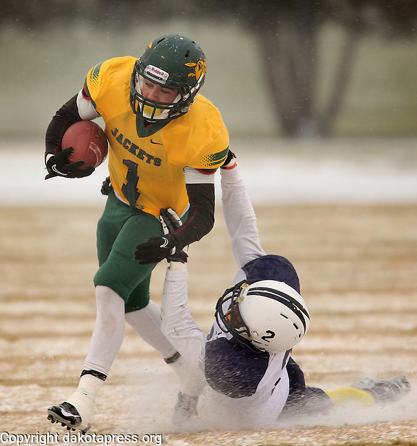 SPEARFISH, SD - NOVEMBER  10, 2012:  Bryar DeSanti #1 of Black Hills State gets pulled down by Ft. Lewis College tackler Jamal Campbell #2 during their Rocky Mountain Athletic Conference football game Saturday at Lyle Hare Stadium in Spearfish, S.D.  (Photo by Richard Carlson/dakotapress.org)