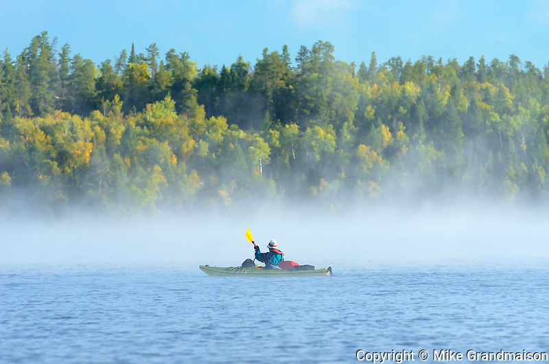 Kayaking on Caddy Lake on a foggy morning<br />Whiteshell Provincial Park<br />Manitoba<br />Canada