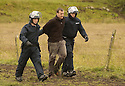 06/07/2005         Copyright Pic : James Stewart.File Name : sct_jspa15 g8 stirling.POLICE ARREST PROTESTERS AFTER THEY BLOCKED THE M9 MOTORWAY AT CAMBUSBARRON NEAR STIRLING....Payments to :.James Stewart Photo Agency 19 Carronlea Drive, Falkirk. FK2 8DN      Vat Reg No. 607 6932 25.Office     : +44 (0)1324 570906     .Mobile   : +44 (0)7721 416997.Fax         : +44 (0)1324 570906.E-mail  :  jim@jspa.co.uk.If you require further information then contact Jim Stewart on any of the numbers above.........
