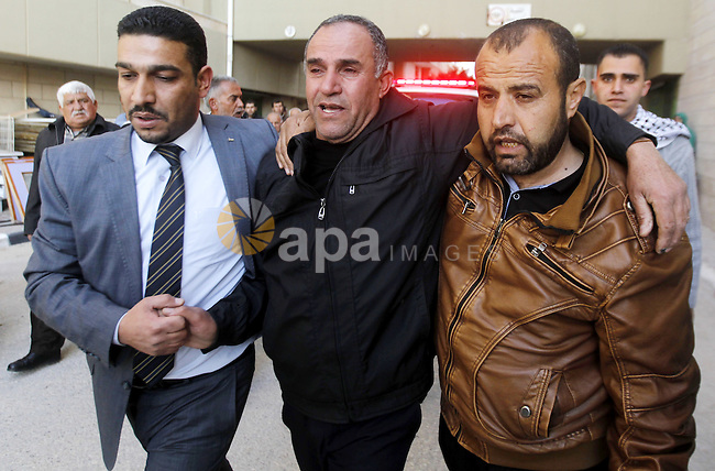 The father of Palestinian Haitham Al-Bau, who was shot and killed by Israeli soldiers, mourns at a hospital in the West Bank city of Hebron February 5, 2016. Israeli soldiers shot and killed Al-Bao, 17, in the occupied West Bank on Friday, hospital officials said, and the Israeli military said he had been about to throw a petrol bomb. Photo by Wisam Hashlamoun