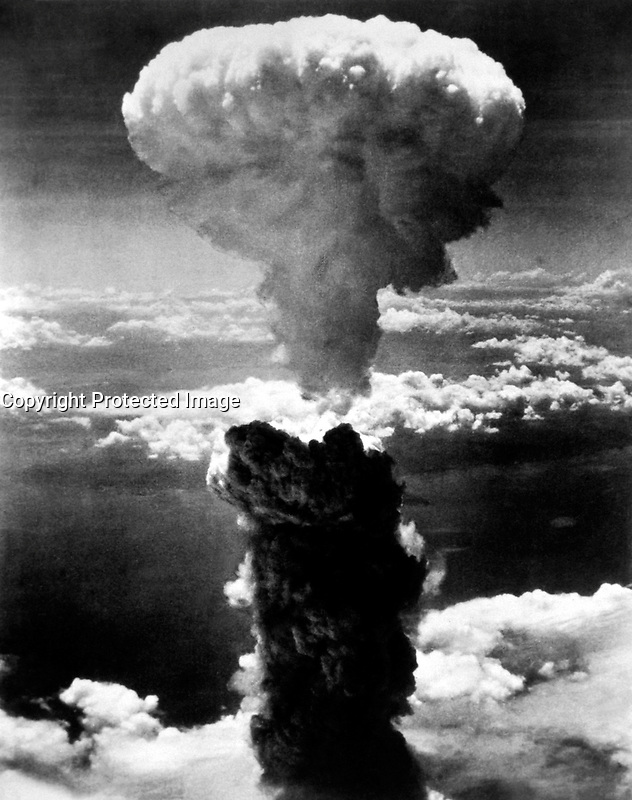 A dense column of smoke rises more than 60,000 feet into the air over the Japanese port of Nagasaki, the result of an atomic bomb, the second ever used in warfare, dropped on the industrial center August 8, 1945, from a U.S. B-29 Superfortress. (OWI).<br /> <br /> The bombs killed as many as 80,000 in Nagasaki by the end of 1945,[3] roughly half on the days of the bombings. Since then, thousands more have died from injuries or illness attributed to exposure to radiation released by the bombs.<br /> <br /> Six days after the detonation over Nagasaki, on August 15, Japan announced its surrender to the Allied Powers, signing the Instrument of Surrender on September 2, officially ending the Pacific War and therefore World War II.