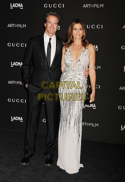 LOS ANGELES, CA - NOVEMBER 01:  Rande Gerber (L) and model Cindy Crawford attend the 2014 LACMA Art + Film Gala honoring Barbara Kruger and Quentin Tarantino presented by Gucci at LACMA on November 1, 2014 in Los Angeles, California.<br /> CAP/ROT/TM<br /> &copy;Tony Michaels/Roth Stock/Capital Pictures