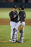 Kannapolis Intimidators catcher Michael Hickman (16) has a meeting with relief pitcher Justin O'Connor (14) during the game against the Hagerstown Suns at Kannapolis Intimidators Stadium on August 26, 2019 in Kannapolis, North Carolina. The Suns defeated the Intimidators 4-1. (Brian Westerholt/Four Seam Images)
