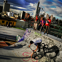 A Colombian BMX biker rides on a ramp, while being watched by his fellows, in the park of La Concordia, Bogotá, Colombia, 25 November 2017.