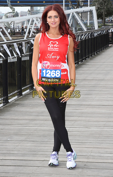 Amy Childs.The Virgin London Marathon celebrities photocall ahead of the actual race on Sunday, The Tower Hotel, London, England..April 17th, 2013.full length red vest tank top 1268 black leggings tights spandex sneakers trainers exercise .ROS/CAP.©Steve Ross/Capital Pictures