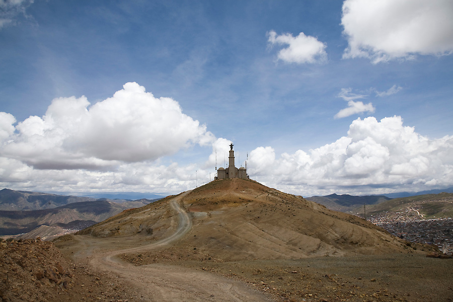 Road winding to a chapel which doubles as a cellular tower on a foothill of the Cerro Rico of Potosí.