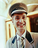 TURKEY, Istanbul, close-up of a smiling mid adult bellboy at the Four Seasons Hotel.