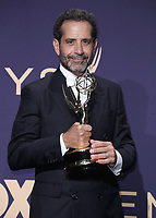 LOS ANGELES - SEPTEMBER 22:  Tony Shalhoub with the award for Outstanding Supporting Actor in a Comedy Series at the 71st Primetime Emmy Awards at the Microsoft Theatre on September 22, 2019 in Los Angeles, California. (Photo by Xavier Collin/Fox/PictureGroup)