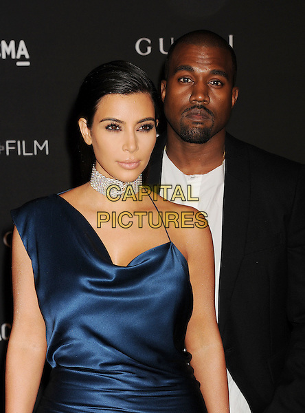 LOS ANGELES, CA - NOVEMBER 01: TV personality Kim Kardashian (L) and recording artist Kanye West attend the 2014 LACMA Art + Film Gala honoring Barbara Kruger and Quentin Tarantino presented by Gucci at LACMA on November 1, 2014 in Los Angeles, California.<br /> CAP/ROT/TM<br /> &copy;Tony Michaels/Roth Stock/Capital Pictures