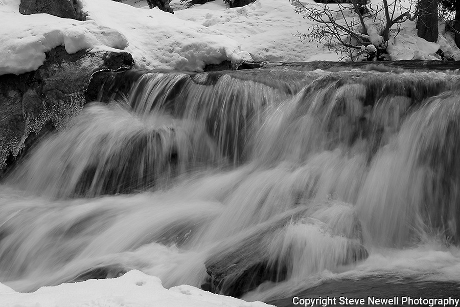 """Smooth Motion"" Black and White.  Eagle Falls waterfall at Emerald Bay, Lake Tahoe, CA.  I hiked out to Lower Eagle Falls above Emerald Bay during the Winter of 2013. The road was closed due to avalanche danger so I had the whole area to myself for the entire day.  Emerald Bay may be the most visited and photographed area in all of Lake Tahoe but on a few days you can enjoy the beauty in solitude. I shot both stills and HD 1080 video of the waterfall and Emerald Bay."
