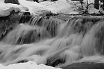 """""""Smooth Motion"""" Black and White.  Eagle Falls waterfall at Emerald Bay, Lake Tahoe, CA.  I hiked out to Lower Eagle Falls above Emerald Bay during the Winter of 2013. The road was closed due to avalanche danger so I had the whole area to myself for the entire day.  Emerald Bay may be the most visited and photographed area in all of Lake Tahoe but on a few days you can enjoy the beauty in solitude. I shot both stills and HD 1080 video of the waterfall and Emerald Bay."""