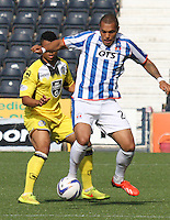 Josh Magennis shielding the ball from Ellis Plummer in the Kilmarnock v St Mirren Scottish Professional Football League Premiership match played at Rugby Park, Kilmarnock on 13.9.14.